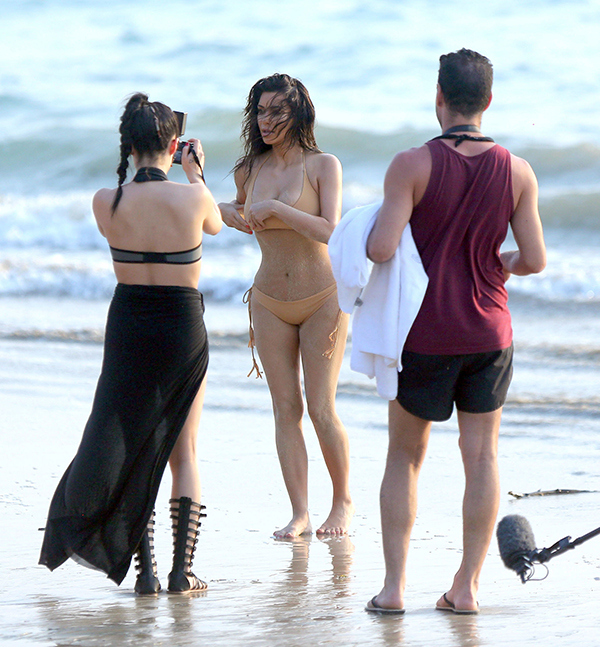 EXCLUSIVE: ***PREMIUM EXCLUSIVE***Kim Kardashian shows off her famous booty in a nude-coloured bikini on a photo shoot in Thailand