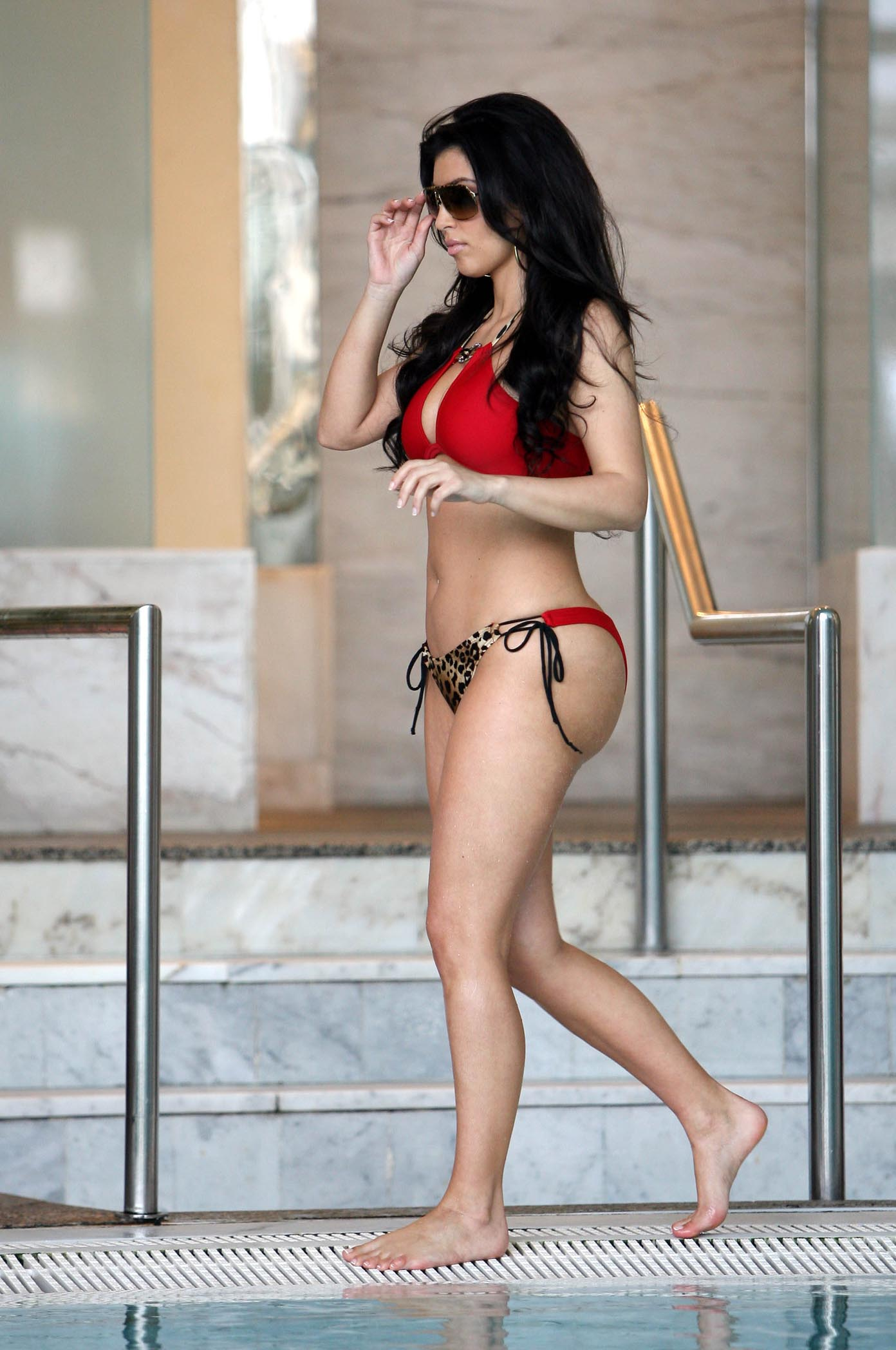 June 12, 2008: Kim Kardashian and sister Kourtney Kardashian (not pictured) show off their bikini bods as they lounge by the pool at the Hotel Hermitage in Monaco. Credit: Jae Donnelly/INFphoto.com Ref.: infusny-101/usla-102